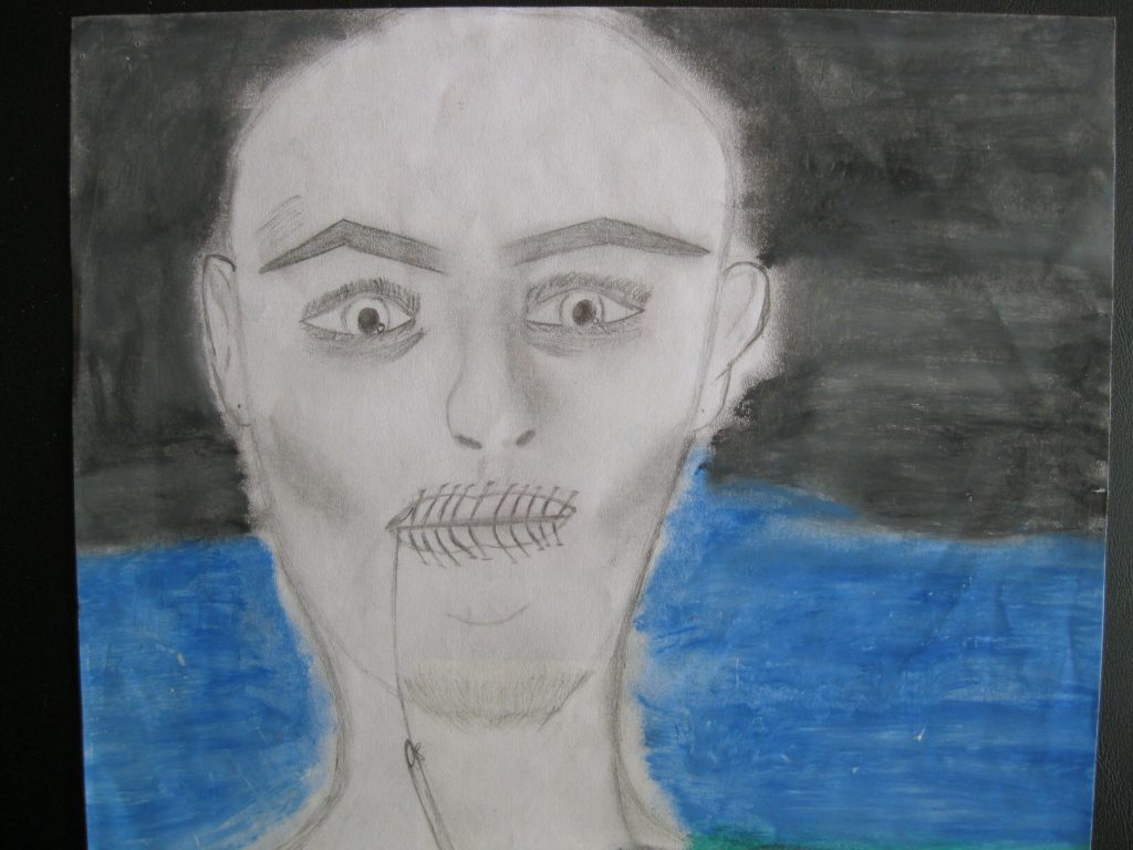 """3rd place Nancy, age 17 """"The truth will set you free"""" The male in my drawing is going through a lot but refuses to tell people about his past."""