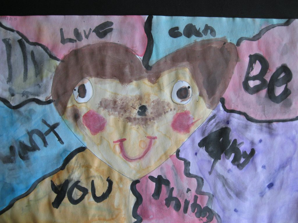 """3rd place Aurora, age 9 """"Love is what you want"""" My art work is about your heart. Love can be whatever you want. All you need is love. Love for everything."""